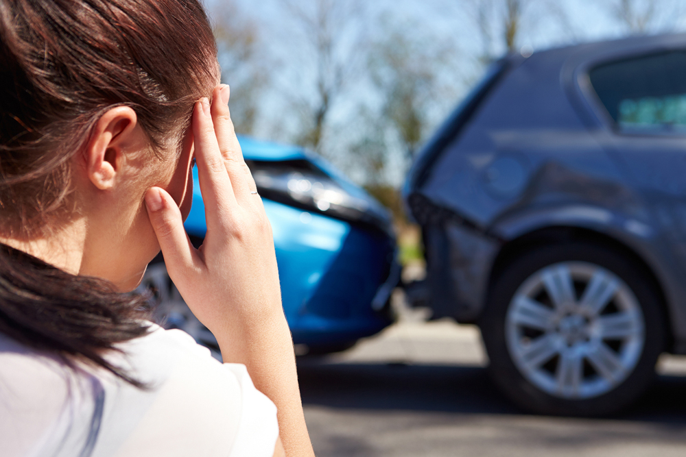 woman looking at auto accident collision