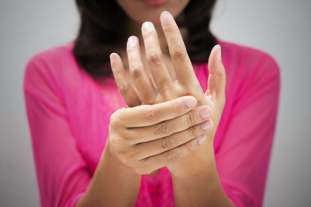 Woman suffering from arthritis
