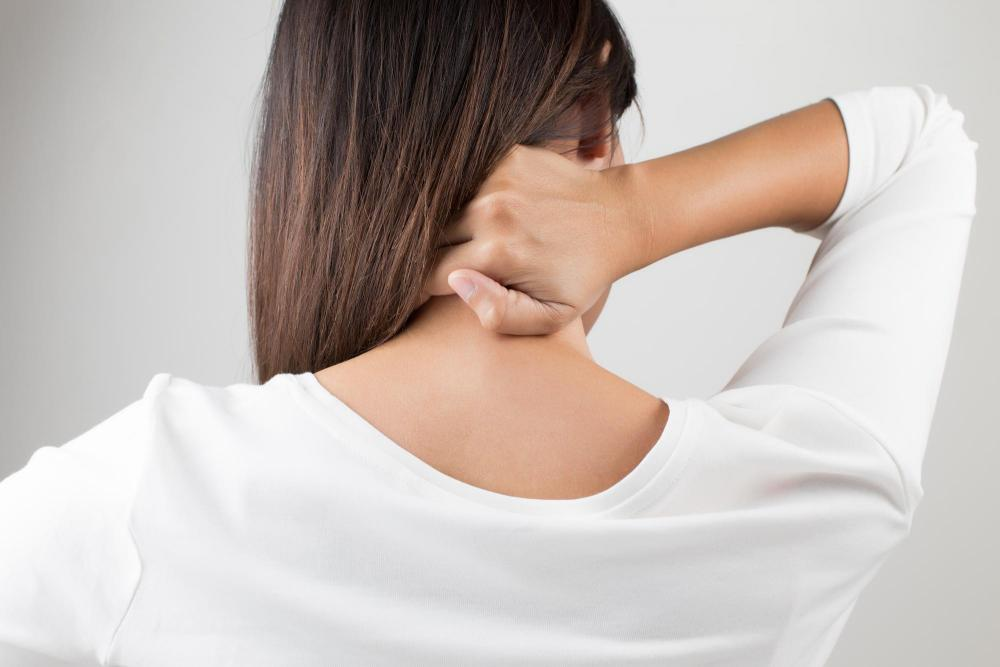 woman with neck pain in Fayetteville